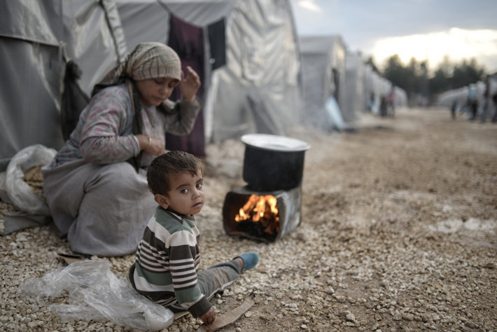 Syrian family in a refugee camp in Turkey, 2015 ( photo by By Orlok Shutterstock.com)