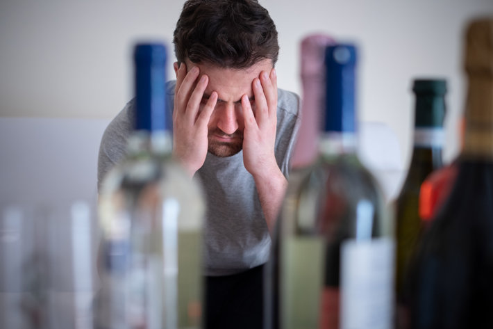 Alcohol addicted man alone having memory problems