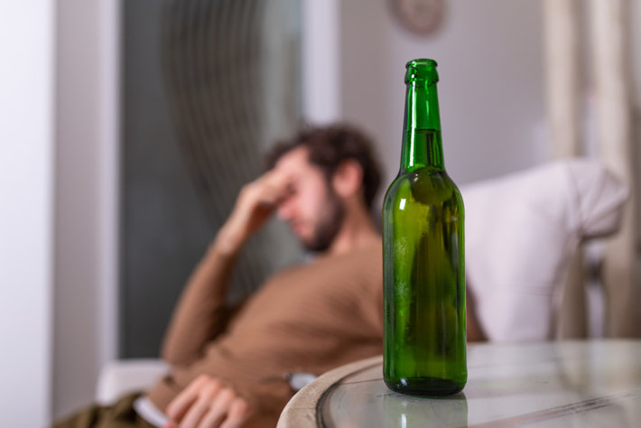 Seek man at home drinks alcohol