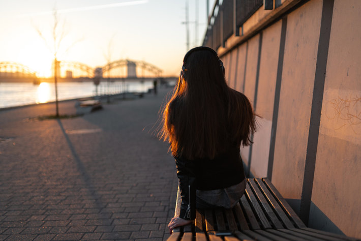 Young woman in recovery is enjoying sunrise.