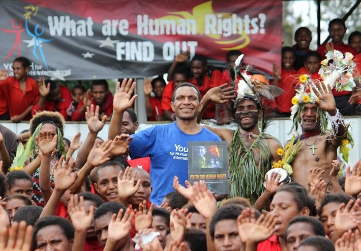 Augustine Brian (in blue) is bringing human rights to life for the people of the Southern Highlands province of Papua New Guinea.