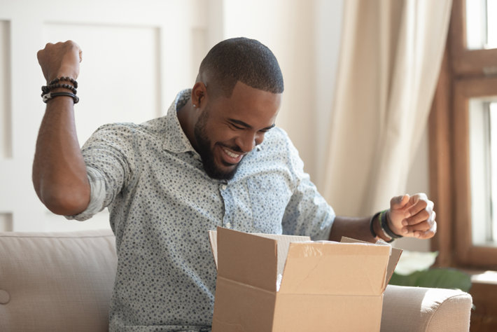 Happy man received package from his wife.