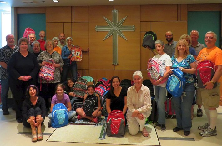 Volunteers from Interfaith Ministries of Greater Queen Anne at a luncheon at the Church of Scientology Seattle, where they prepared backpacks and school supplies to donate to local underserved children.