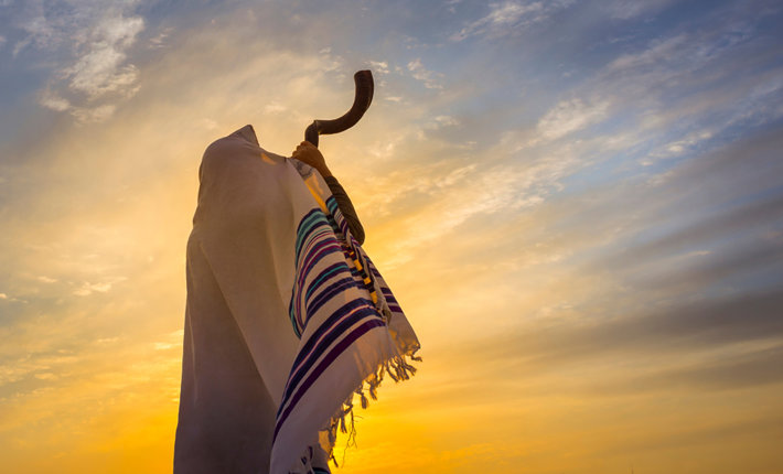 The blowing of the shofar, which begins the celebration of Rosh Hashana. (photo by John Theodor, Shutterstock.com)