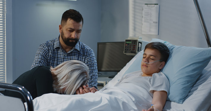 Teenage son in hospital, parents crying