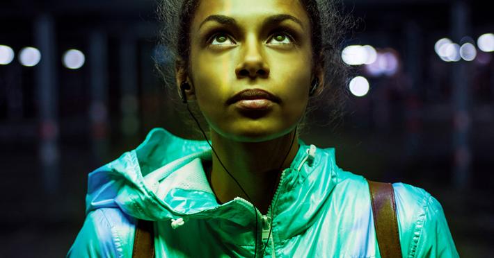 Young woman looking at the marijuana ad.