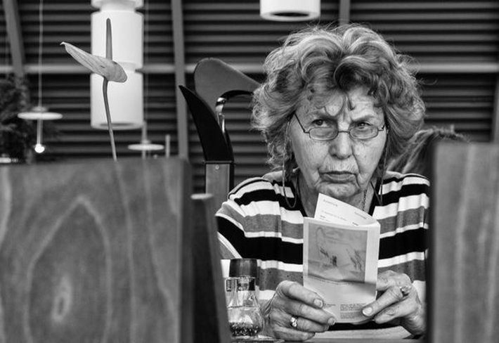 Older Lady Reading Looking Concerned