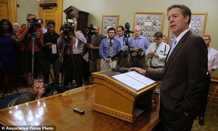 Kansas Gov. Sam Brownback talks to reporters Thursday, July 27, in Topeka, Kansas., after being nominated to be Ambassador-at-Large for International Religious Freedom. (AP Photo/Charlie Riedel)