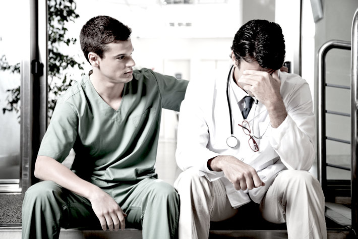 Doctor helps upset friend-doctor.