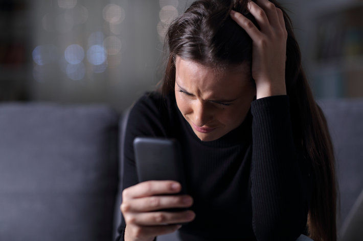 Girl feeling sad with smart phone