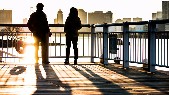 Sunny morning in the city, man and woman standing.