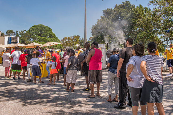 Residents of North Greenwood are served a complimentary barbeque put on by the Church of Scientology Volunteer Ministers