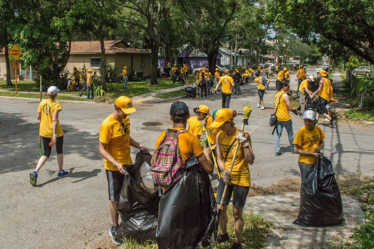 Volunteer Ministers clean up the community
