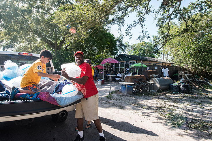 Neighbor to neighbor. Scientology Volunteer Ministers help deliver much-needed ice to North Greenwood residents