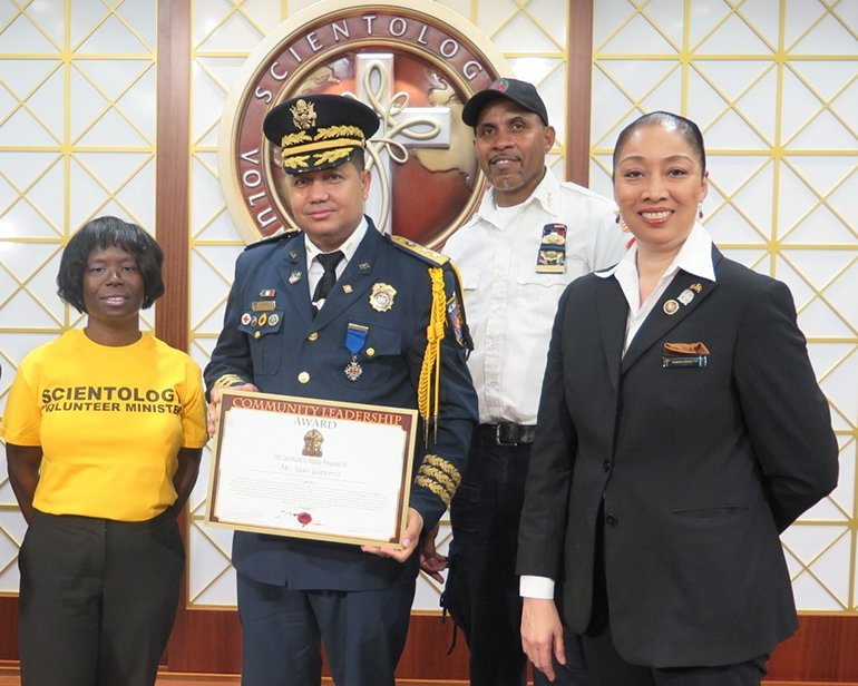 Mr. Juan Gutierrez. Executive Director of La Academia Mundial Bomberos (World Academy of Firefighters) is presented the Community Leadership Award by the Church of Scientology Harlem.