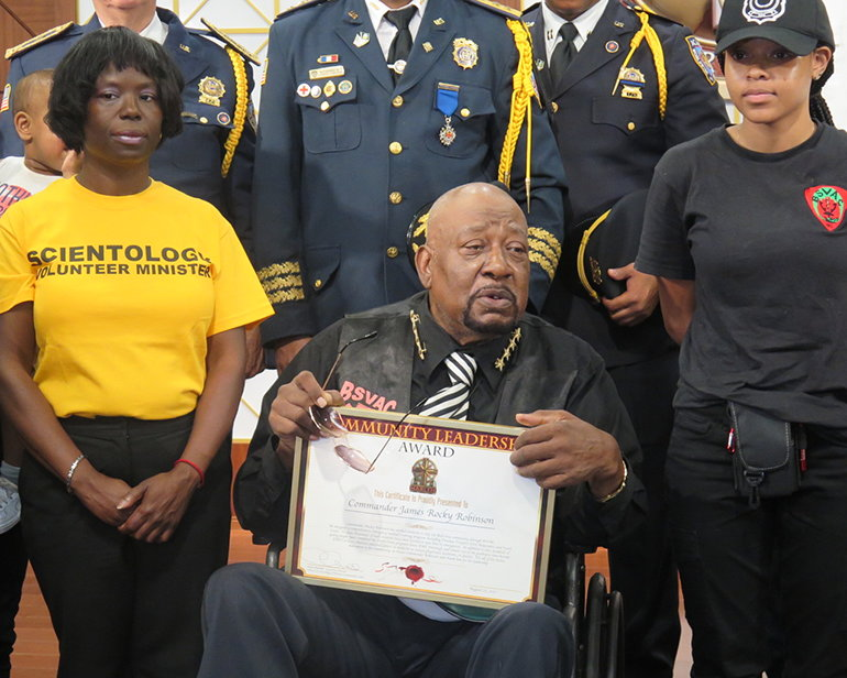 """Commander James """"Rocky"""" Robinson of the Bedford-Stuyvesant Volunteer Ambulance Corps is presented the Community Leadership Award by the Church of Scientology Harlem."""