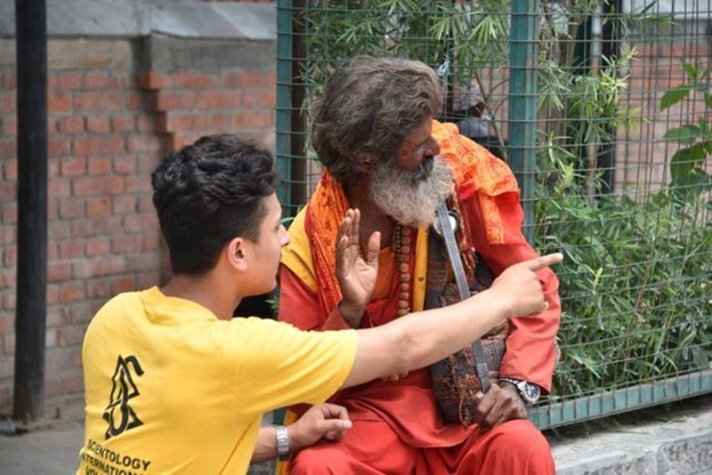 Scientology Volunteer Minister provides an assist to a Hindu devotee in Kathmandu