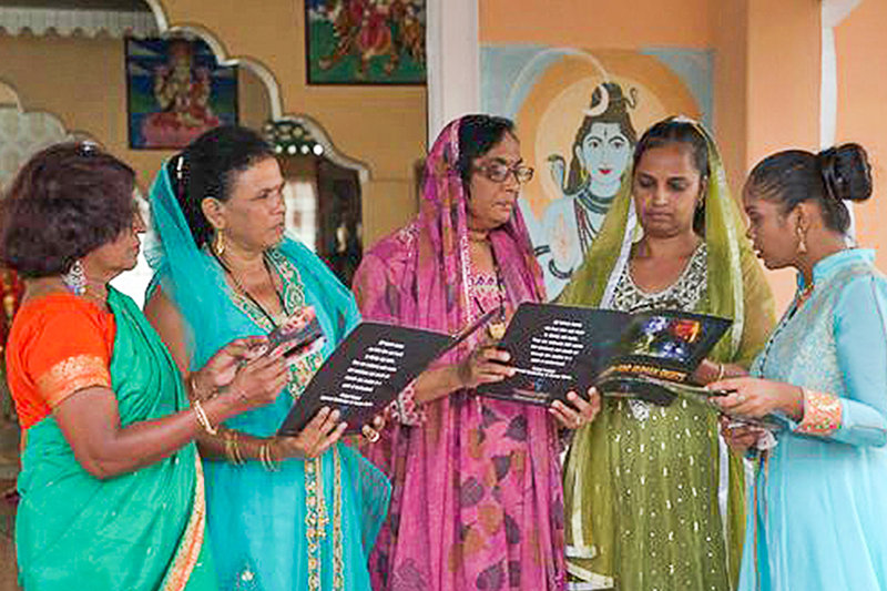 Ladies in a Hindu temple and attentive students enjoy Youth for Human Rights workshops, both in Guyana, South America.