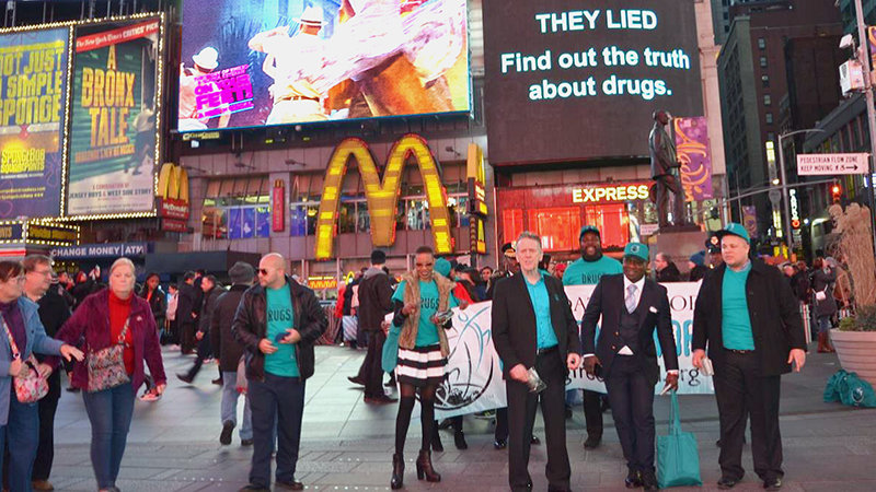 Drug-Free World volunteers hand out Truth About Drugs booklets in Times Square.