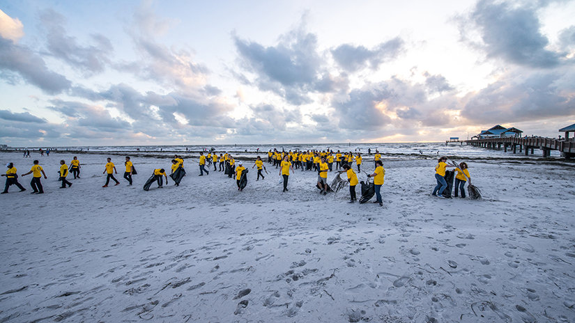 Volunteer Ministers walking into the beach