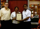 Spring Valley, New York, Mayor Noramie Jasmin  (center) awards Ralph Mary Gedeon