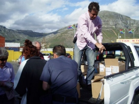 David and his team unload thousands of The Truth About Drugs booklets and prepare their massive distribution.