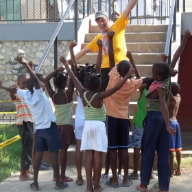 Australian Volunteer Minister Peter Dunn, helping to raise the spirits of group of Haitian children