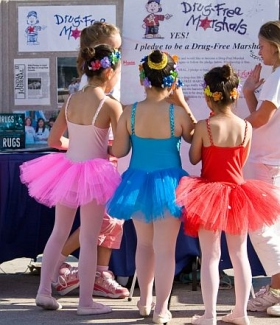 Young Ballerinas in Toronto pledge to be drug-free at one of the many information booths manned by Scientology volunteers