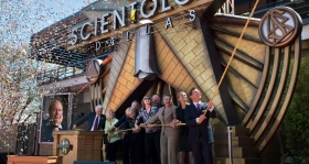 Mr. Miscavige is joined by Church executives and honored guests to pull the ribbon and officially open the doors the new Church of Scientology of Dallas.