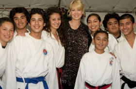 Jenna Elfman with PAL Marshal Arts students who gave a demonstration of their skills at the 17th annual