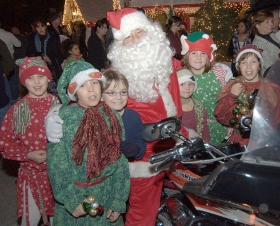 Santa Claus arrived at the Clearwater, Florida Winter Wonderland on a custom red and white Harley Davidson Road Glide.