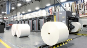 The 121-ton web press uses 10-mile-long paper rolls and can print 55,000 pages per hour, in more than a dozen languages.