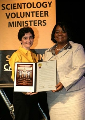 Georgia State Senator Donzella James presented a resolution to the international director of the Scientology Volunteer Ministers Corps in Los Angeles Saturday, acknowledging the group's Haiti Disaster Response.