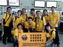 Proud to help: the Taiwanese Volunteer Ministers at Kaohsiung airport before taking off for the four-hour flight to Tokyo.