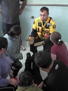 Alejandro Del Llano (in the yellow uniform) who directs Volunteer Ministers activities in Latin America