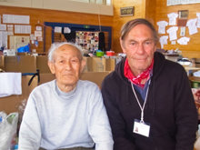 Peter Dunn (right) with a man he helped in a school gymnasium converted to a shelter for those displaced by the March 2011 earthquake