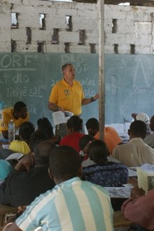 Ayal Lindeman (center), delivering a seminar on community health and first-aid in Carrefour, Haiti.