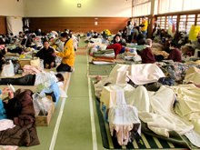 Volunteer Ministers helping survivors in a shelter in Onagawa, Japan. Many of the shelters are located in schools, hospitals and public gyms.