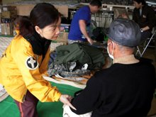 A Japanese Volunteer Minister giving a touch assist.