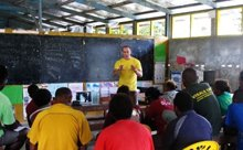 A Volunteer Minister of the South Pacific Goodwill Tour covers information to improve teacher and student performance at a workshop at Visale Primary School