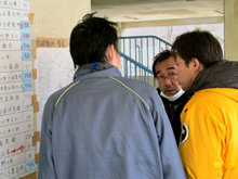 Scientology Volunteer Ministers reviewing the location of shelters in the Miyagi Prefecture.